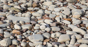 Grey pebbles and stones background texture found on the beach in St Audries Bay Somerset. Grey pebbles and stones and shingle, a background texture found on the Royalty Free Stock Photos