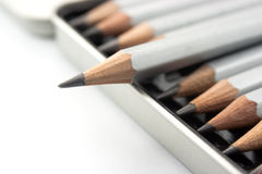 Grey pencil. In box on white background royalty free stock photo
