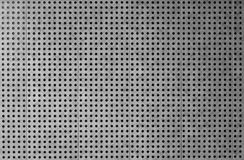 Grey perforated metal cladding background Royalty Free Stock Image