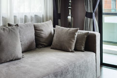 Grey pillows on modern sofa Royalty Free Stock Images
