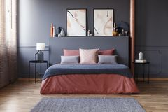 Grey and pink hotel bedroom royalty free stock photos