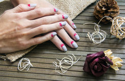 Grey with pink moon nail art manicure Royalty Free Stock Photo