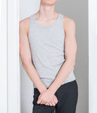 Grey plain male sleeveless t-shirt. Man`s grey tang-top shirt Royalty Free Stock Photo