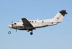 Grey plane landing Stock Image