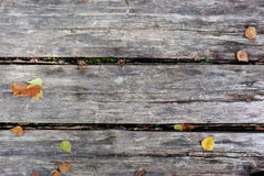 Grey planks with fall leaves Stock Photography