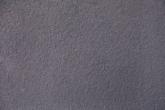 The grey plaster on the wall. Shagreen. The gray background Stock Images