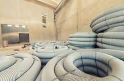 Grey plastic corrugated pipe inside a warehouse Stock Photos