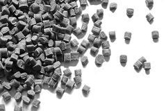 Grey plastic granulate. Grey colored granulat pellets of thermoplastic material Stock Photo