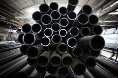 Grey plumbing pipes, industry, manufacture of pipes Stock Photo