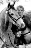 Grey pony and girl Royalty Free Stock Photo