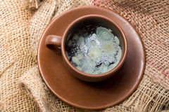 Grey powder in coffee cup Stock Images