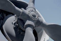 Grey propeller on White Historic World War II plane Stock Photos