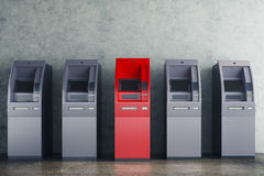 Grey and red ATM in concrete interior. Grey and red ATM machines in clean concrete interior. Payment and currency concept. 3D Rendering Stock Photography