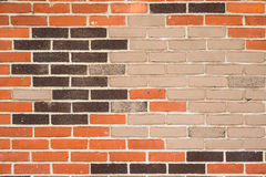 Grey, red and black brick wall Stock Photos