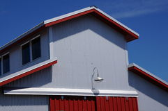 Grey and red building. A grey and red building with blue sky Royalty Free Stock Photos