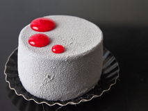 Grey red pastry dessert, black surface Stock Photos