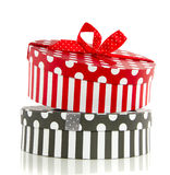 A grey and red giftbox. A grey and red white dotted striped round giftbox isolated over white royalty free stock photo