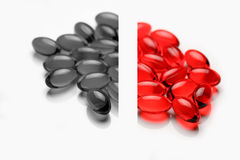 Grey and red pills Royalty Free Stock Images