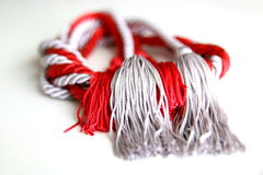 Grey and red ropes with tassel isolated Stock Photo