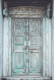 Grey retro style wooden door with rusty latch background, textur Royalty Free Stock Photo