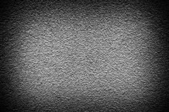 Grey revetment wall putty high contrasted with vignetting effect macro texture Royalty Free Stock Photography