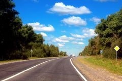 Grey road and blue sky Royalty Free Stock Photography