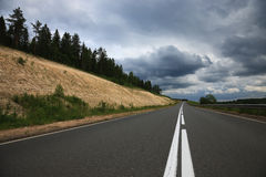 Grey road, grey clouds Royalty Free Stock Photography