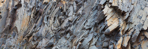 Grey rock mountain panorama background - stone texture Stock Photography