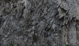 Grey rock mountain panorama background - stone texture Stock Images
