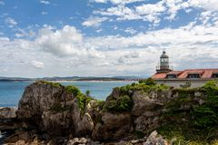 Santander lighthouse on the rocks Cantabria Spain stock photo