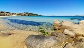 Grey rocks and golden sand in Cala Battistoni Royalty Free Stock Photos