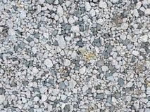 Grey rocks and pebbles stock photo