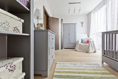 Grey room with baby cot Stock Photos
