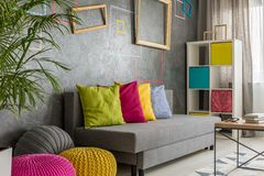 Grey room with colorful poufs Stock Photo