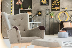Grey room with stylish upholstered chair Stock Image