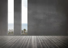 Grey room with windows showing the ocean Stock Photography
