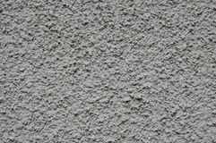Grey rough plaster on wall closeup Royalty Free Stock Photo
