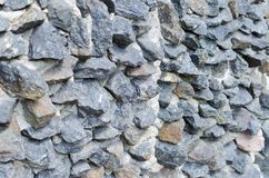 Grey rough stone masonry on facade Texture royalty free stock image