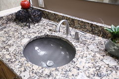Grey round sink with granite counter. Royalty Free Stock Image