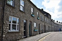 Grey row of homes. Quaiet town street with grey stone homes. Charming old quater of Armagh City Stock Images