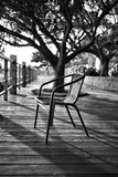 Grey-scale Photo of Chair Royalty Free Stock Images