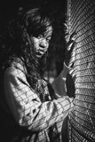 Grey Scale Photography of Woman Standing Against Mesh Grill Stock Photography