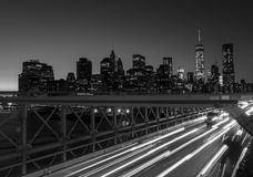Grey Scale and Time Lapse Photography of a Bridge With Car during Night Time Stock Photos