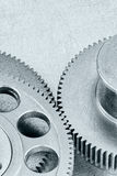 Grey scratched metal technology background with industrial cogwh Stock Image
