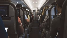 Grey Seats Inside the Plane and Person Occupied Sitting Royalty Free Stock Images