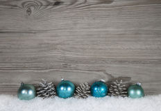 Grey shabby chic christmas background with wood, fir cone and ba Royalty Free Stock Image