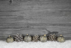 Grey shabby chic christmas background with wood, fir cone and ba Royalty Free Stock Photos