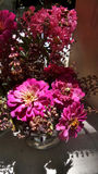Grey shadow of pink flowers vase from home garden. Pink Zinnia and Crape Myrtle flowers in ine vase stock image