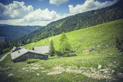 Grey Shed Surrounded by Green Grass during Daytime Royalty Free Stock Images