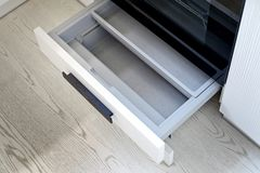Grey Shelf Under der Ofen Stockbilder